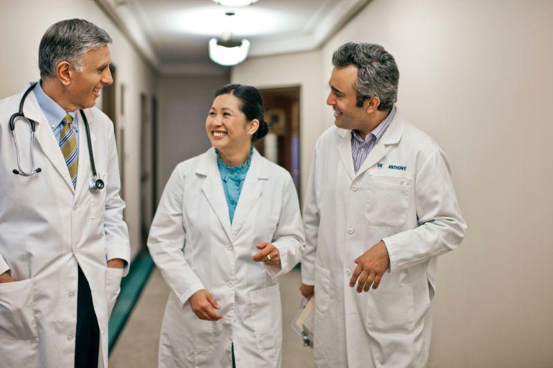 doctors talking in a hallway